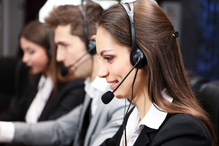 Facilitron support portraying people with phone headsets